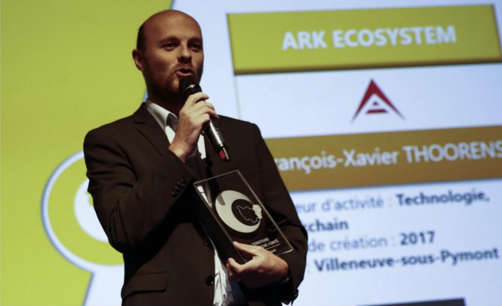 """François-Xavier THOORENS, CTO de ARK ECOSYSTEM, lors de la remise du trophée de la """"Meilleure entreprise internationale de Franche-Comté"""" 2018."""